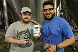 Joel Kodner, left, poses with Manny Carrera from Argyle Coffee Roasters. He's holding a bag of coffee sold in the Due South Taproom from the same roast used in Java Mariana Trench, the coffee variant of the brewery's yearly imperial stout.
